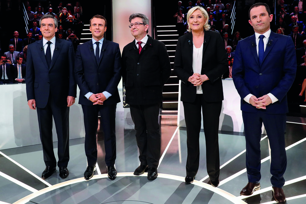 Candidates for the 2017 presidential election (LtoR) Francois Fillon, former French Prime Minister, member of the Republicans and candidate of the French centre-right, Emmanuel Macron, head of the political movement En Marche !, or Onwards !, Jean-Luc Melenchon of the French far left Parti de Gauche, Marine Le Pen, French National Front (FN) political party leader and Benoit Hamon of the French Socialist party (PS) pose before a debate organised by French private TV channel TF1 in Aubervilliers, outside Paris, France, March 20, 2017. REUTERS/Patrick Kovarik/Pool - RTX31WQ7