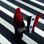 Manifestante contra a guerra na Síria sobre a faixa de pedestre na Avenida Paulista